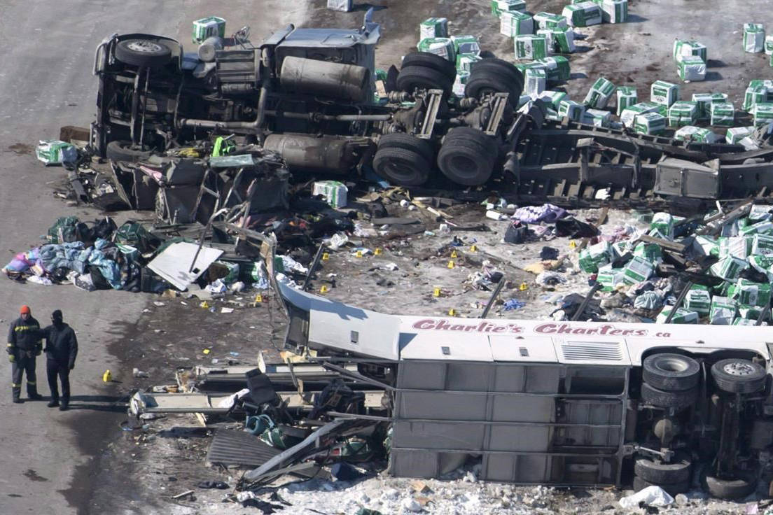 The wreckage of a fatal crash involving the Humboldt Broncos hockey team bus outside of Tisdale, Sask., is seen on Saturday, April, 7, 2018. THE CANADIAN PRESS/Jonathan Hayward