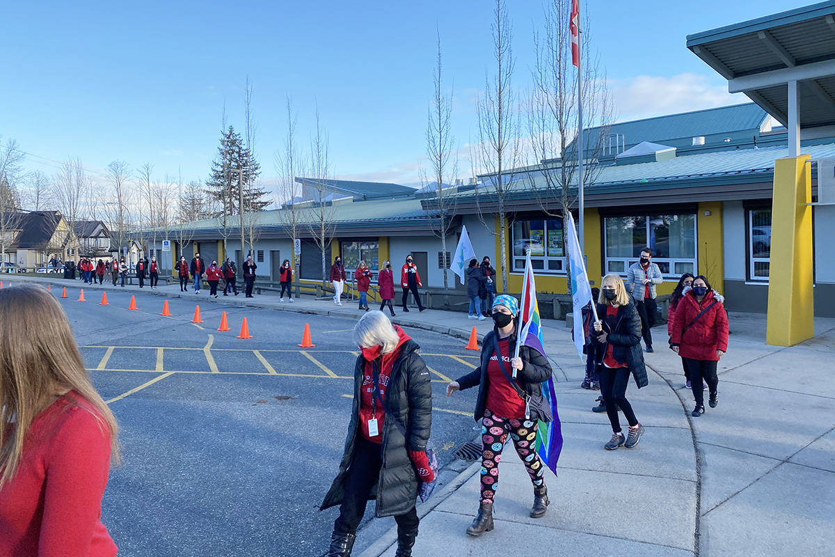 "Teachers and support staff at Surrey's Ecole Woodward Hill hold flags and wear red during a ""walk-in"" outside the school on Tuesday. (Submitted photo: Matt Westphal)"