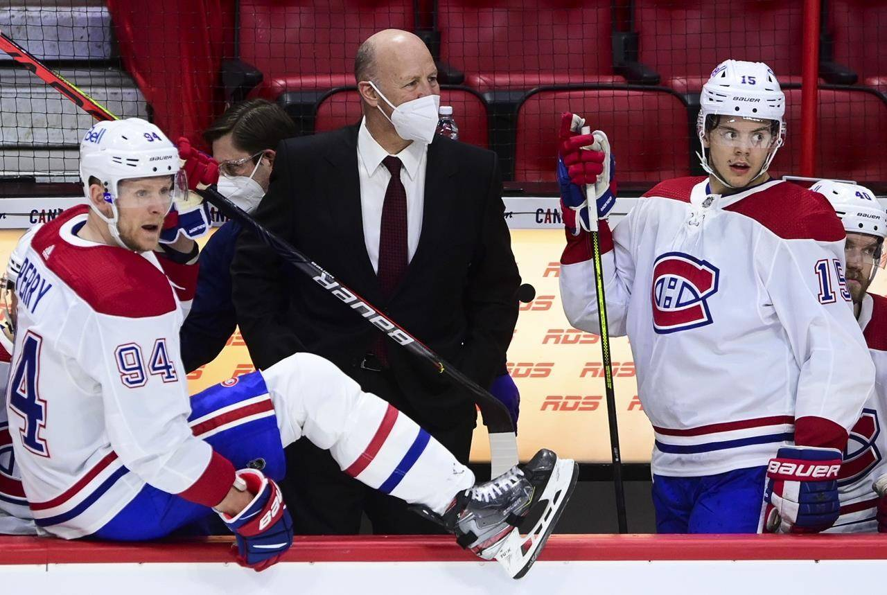 Montreal Canadiens head coach Claude Julien looks towards the ice as his team takes on the Ottawa Senators during second period NHL action in Ottawa on Tuesday, Feb. 23, 2021. The Canadiens have fired head coach Julien and associate coach Kirk Muller. THE CANADIAN PRESS/Sean Kilpatrick