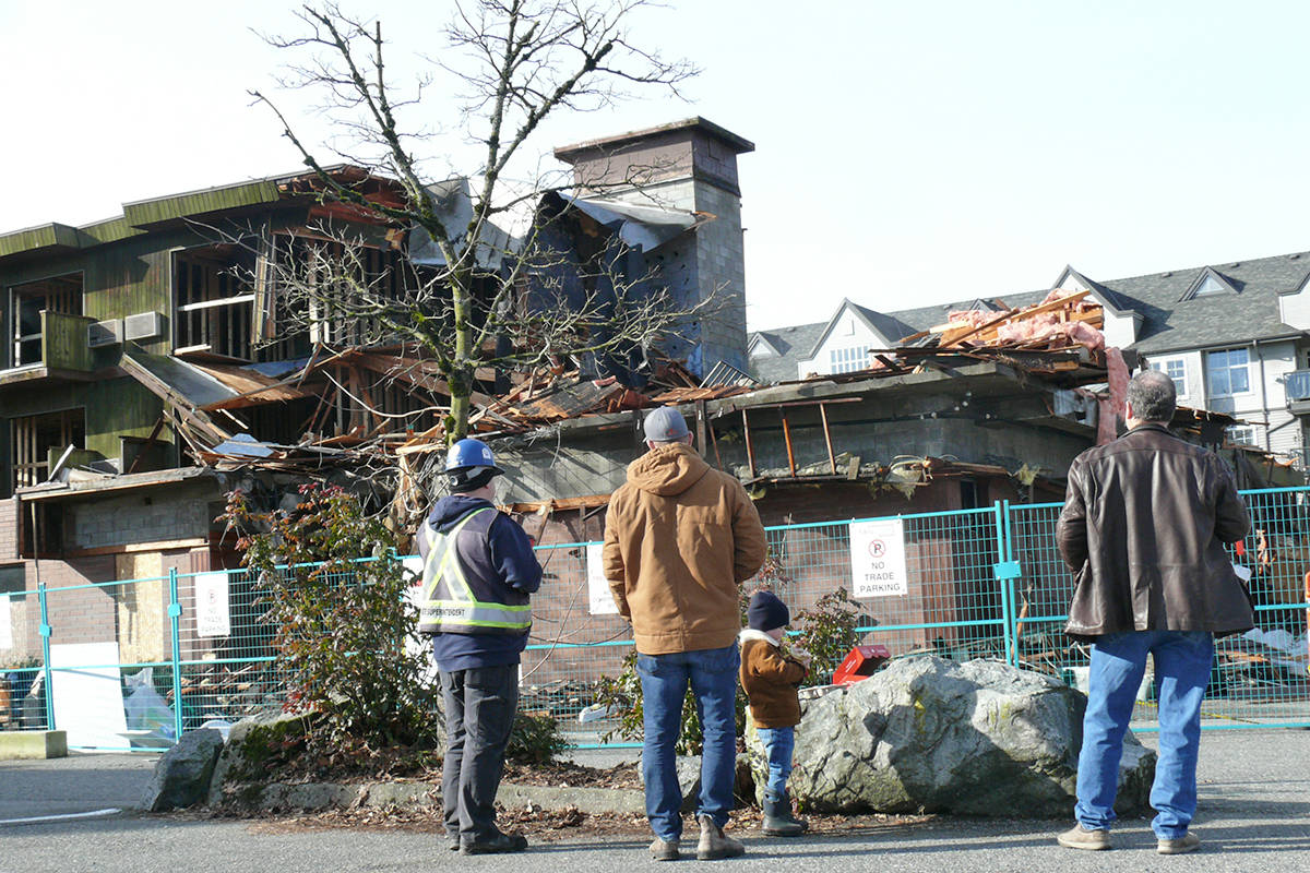 Demolition of the West Country Hotel in Langley City on 56th Avenue near 202nd Street got underway on Wednesday, Feb. 24, 2021. The site will be redeveloped for a rental housing project. (Dan Ferguson/Langley Advance Times)