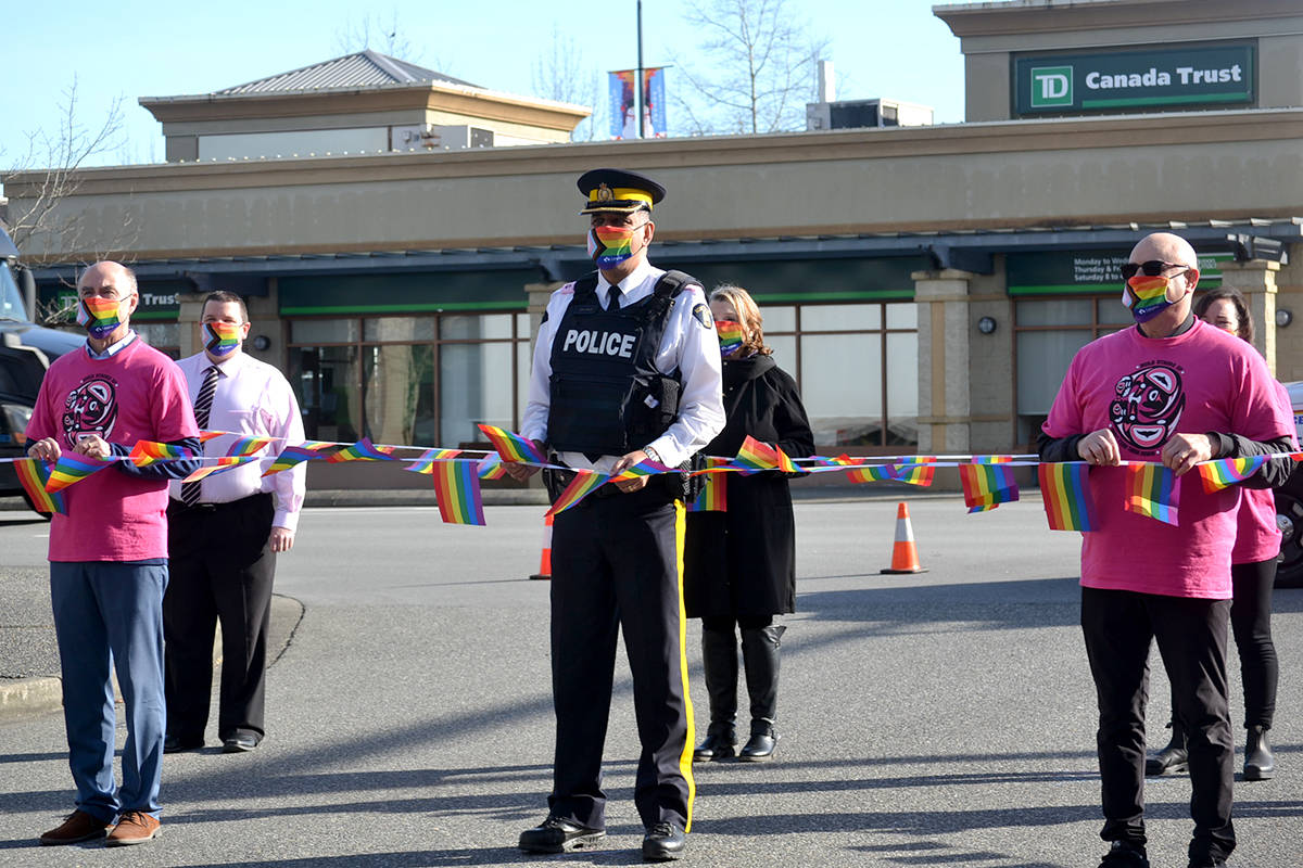 Langley RCMP officers and Langley School District employees marked a rainbow crosswalk at 48A Avenue and 222 Street on Wednesday, Feb. 24, for Pink Shirt Day. (Ryan Uytdewilligen/Aldergrove Star)