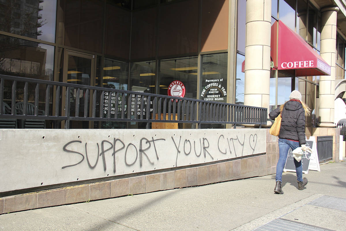 """Support your city"" reads a piece of graffiti outside the Ministry of Finance office. (Jane Skrypnek/News Staff)"