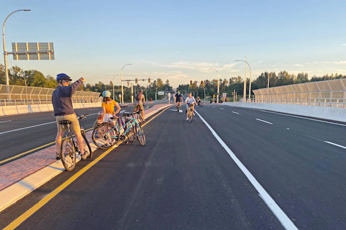 Cyclists checked out the 216th interchange crossing the night before it opened to motor vehicles in early September, 2020. The overpass has separated bike lanes for riders. (Mitchell Nurse/Special to the Langley Advance Times)