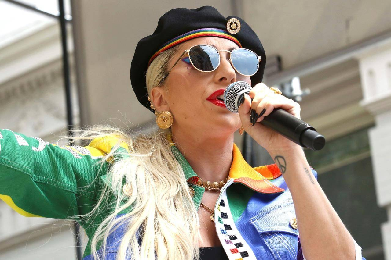 FILE - This June 28, 2019 file photo shows Lady Gaga performing in the second annual Stonewall Day honoring the 50th anniversary of the Stonewall riots, hosted by Pride Live and iHeartMedia in New York. Officials say Lady Gaga's dog walker was shot and her two French bulldogs stolen in Hollywood during an armed robbery. Los Angeles police are seeking two suspects, thought it's not known if both were armed, in connection with the Wednesday night shooting. (Photo by Greg Allen/Invision/AP, File)