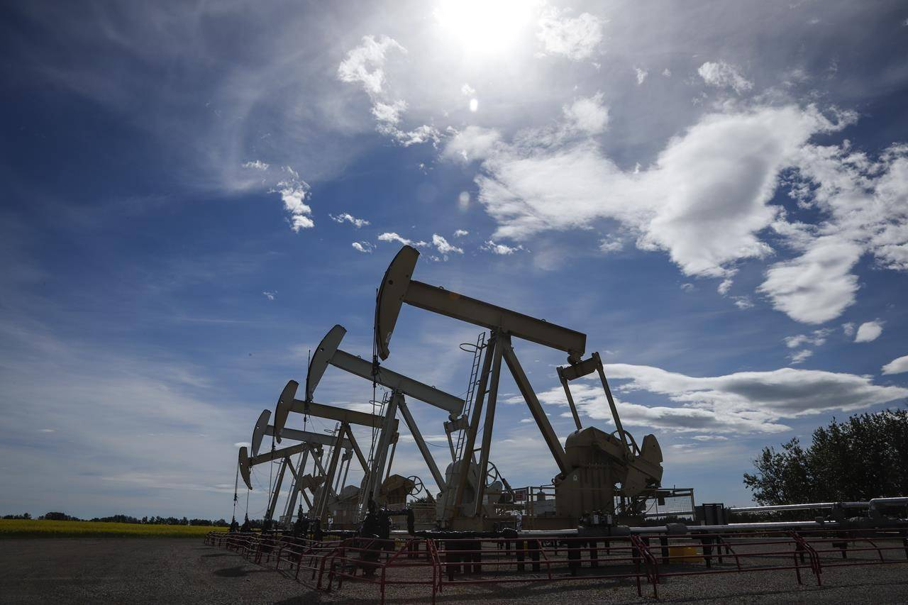 Pumpjacks draw oil out of the ground near Olds, Alta., Thursday, July 16, 2020. A new report suggests the economic impact of the pandemic led to a massive increase in federal aid to Canada's oil patch. THE CANADIAN PRESS/Jeff McIntosh