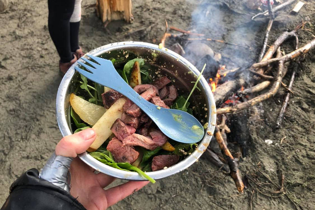 Campfire-grilled steak on a peach, spinach salad. Meal prep kits even work in the backcountry, as proven by this industrious camper. (Marg Leehane photo)