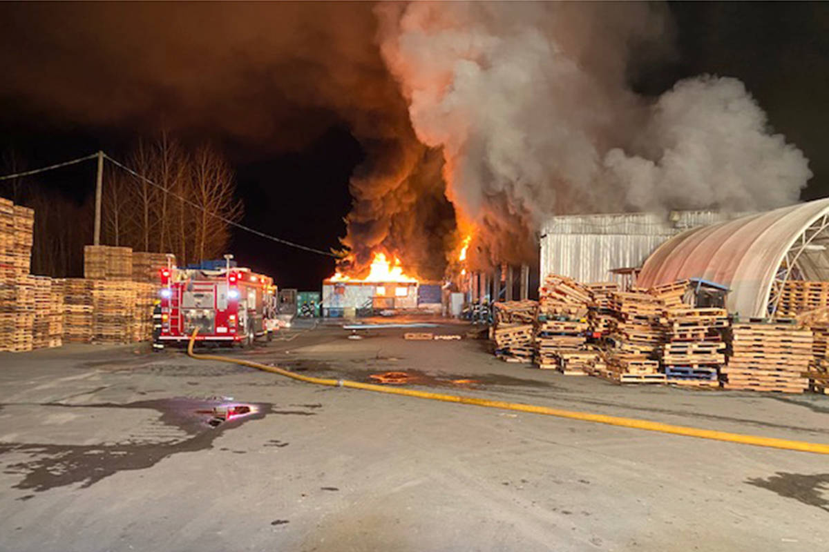 Township firefighters were called to battle a heavy blaze at a pallet factory in Glen Valley at 256 Street and 88 Avenue just after 11 p.m. on Thursday, Feb. 25, 2021. (Andy Hewitson/Special to Langley Advance Times)