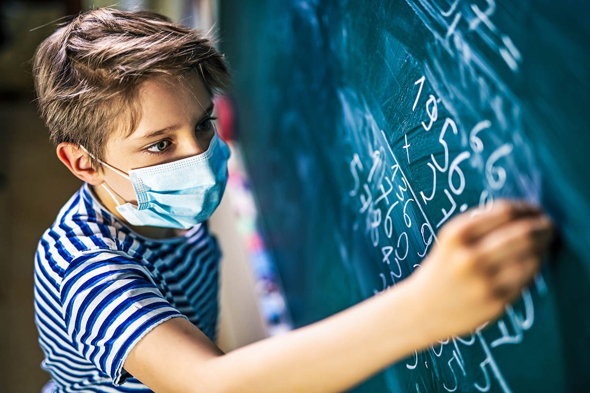 A kid in elementary school wearing a face mask amid the COVID-19 pandemic. (Metro Creative)