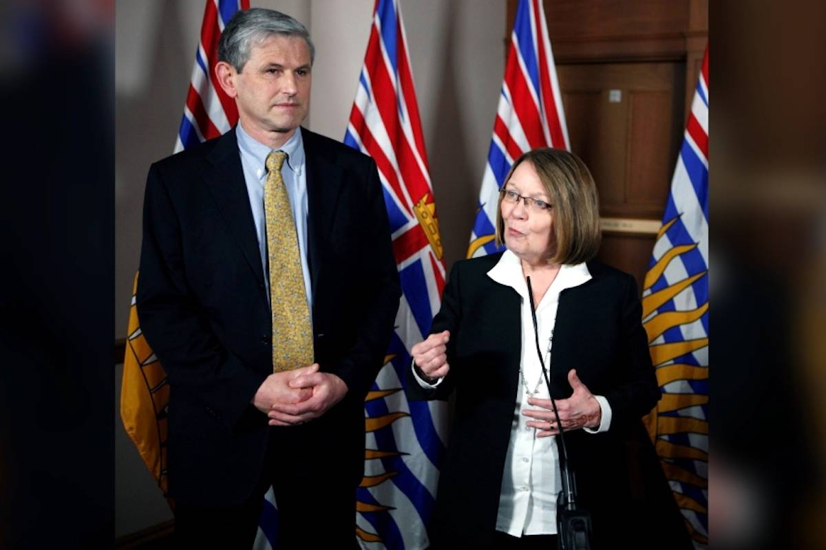 Then-Liberal leader Andrew Wilkinson looks on as MLA Shirley Bond answers questions during a press conference at Legislature in Victoria. (Chad Hipolito / THE CANADIAN PRESS)