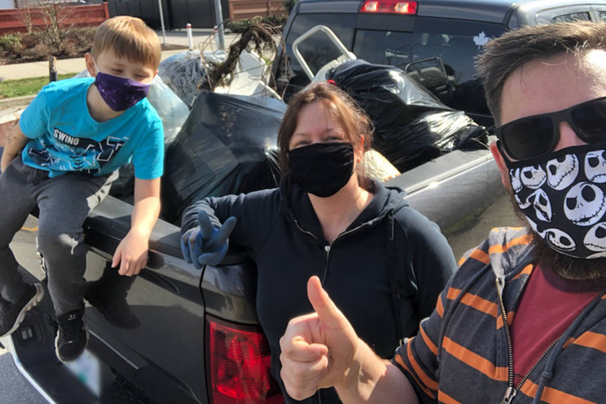 It didn't take long to fill a truck with discarded trash from a vacant lot on 198A Street near 72nd Avenue near the Willoughby Heights home on Saturday, Feb. 27, 2021. Alex Corkun (L), Meghan Rodger and Jay Corkum (R) made two trips (Jay Corkum/special to Langley Advance Times)