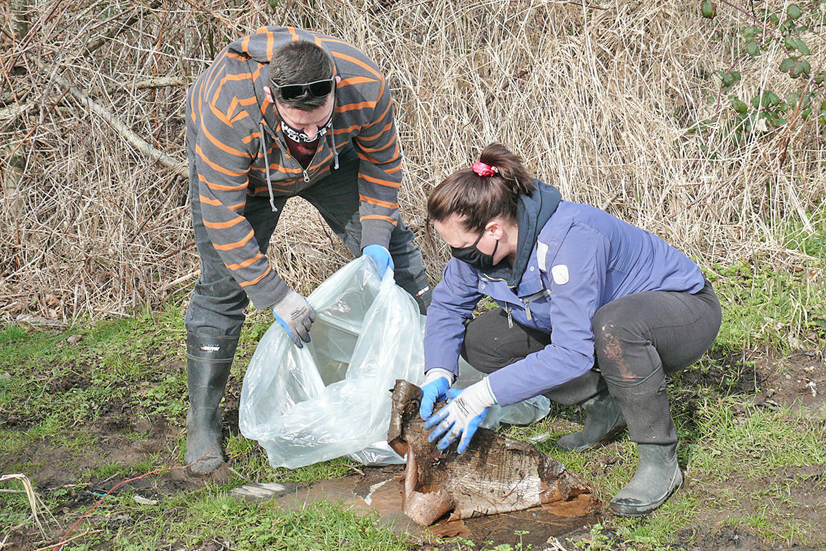 Jay Corkum and Meghan Rodger filled up several bags with discarded trash from a vacant lot on 198A Street near 72nd Avenue near the Willoughby Heights home on Saturday, Feb. 27, 2021 (Dan Ferguson/Langley Advance Times)