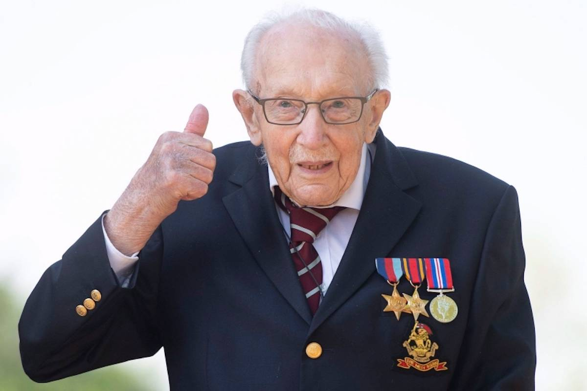 War veteran Captain Tom Moore, poses for a photo at his home in Marston Moretaine, England, after he achieved his goal of 100 laps of his garden, raising millions of pounds for the NHS. (Joe Giddens/PA via AP)