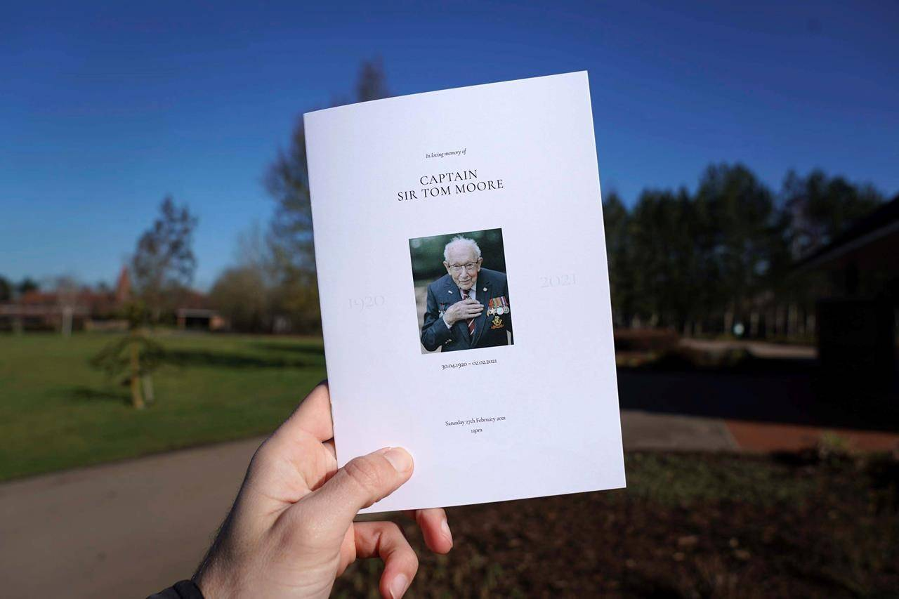A view of the Order of Service for the funeral of Captain Tom Moore at Bedford Crematorium, in Bedford, England, Saturday, Feb. 27, 2021. (Joe Giddens/Pool Photo via AP)