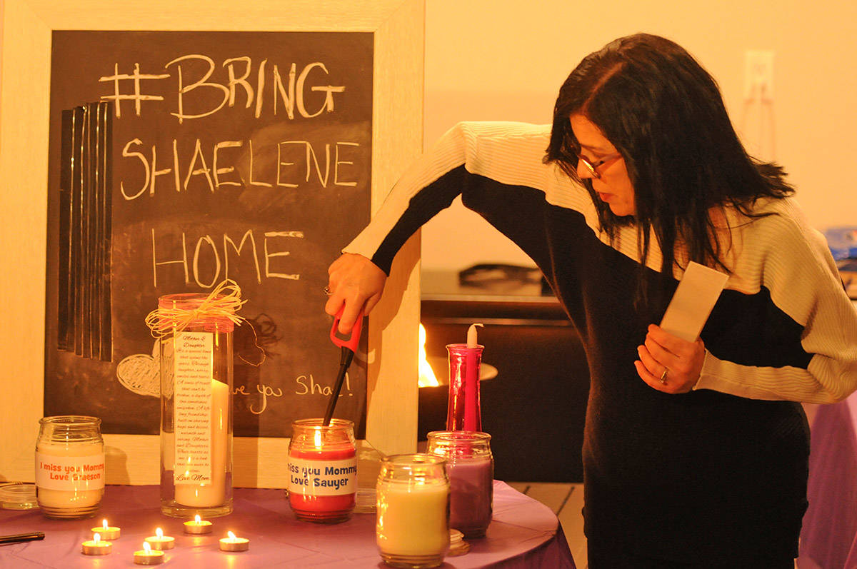 Alina Durham, mother of Shaelene Bell, lights candles on behalf of Bell's two sons during a vigil on Saturday, Feb. 27, 2021. (Jenna Hauck/ Chilliwack Progress)