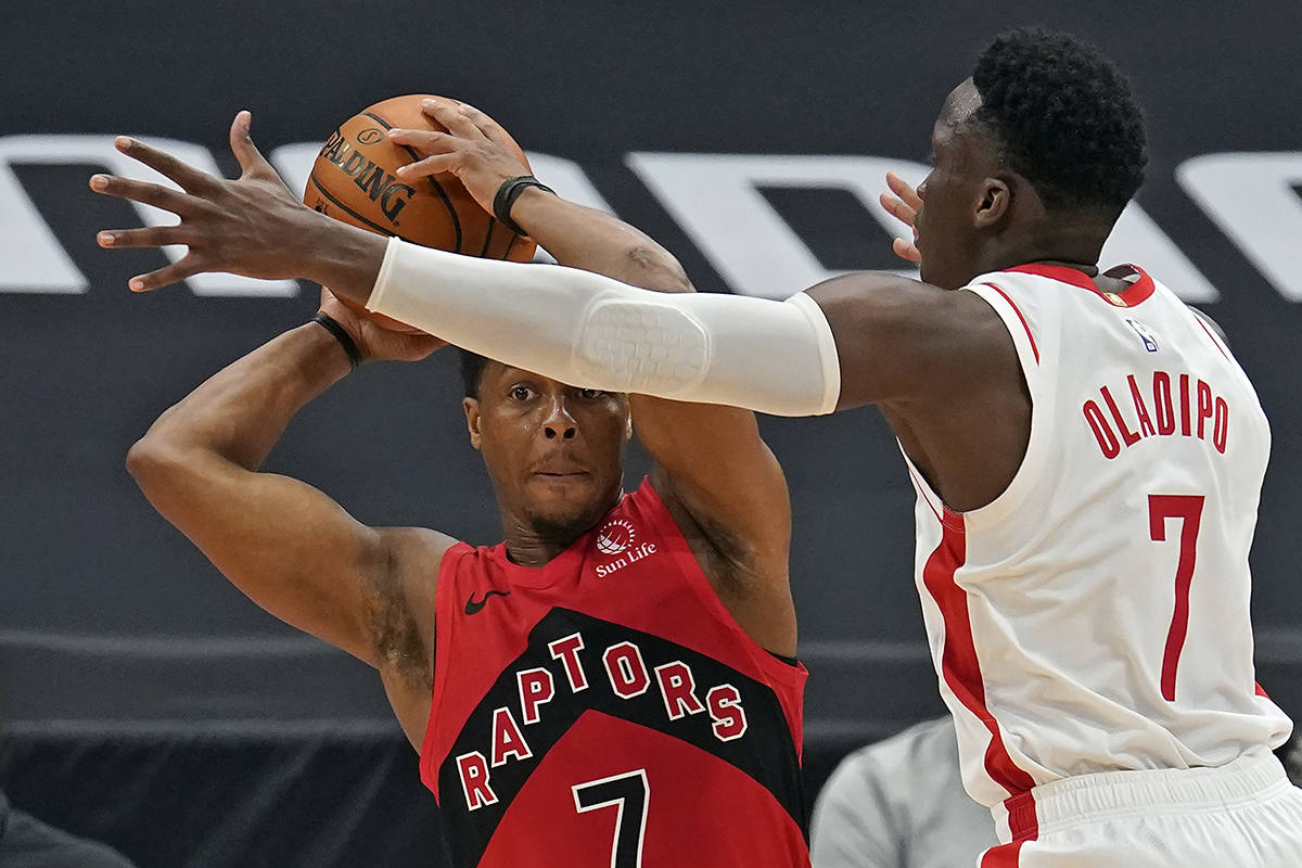 Houston Rockets guard Victor Oladipo, right, blocks a pass attempt by Toronto Raptors guard Kyle Lowry during the second half of an NBA basketball game Friday, Feb. 26, 2021, in Tampa, Fla. (AP Photo/Chris O'Meara)