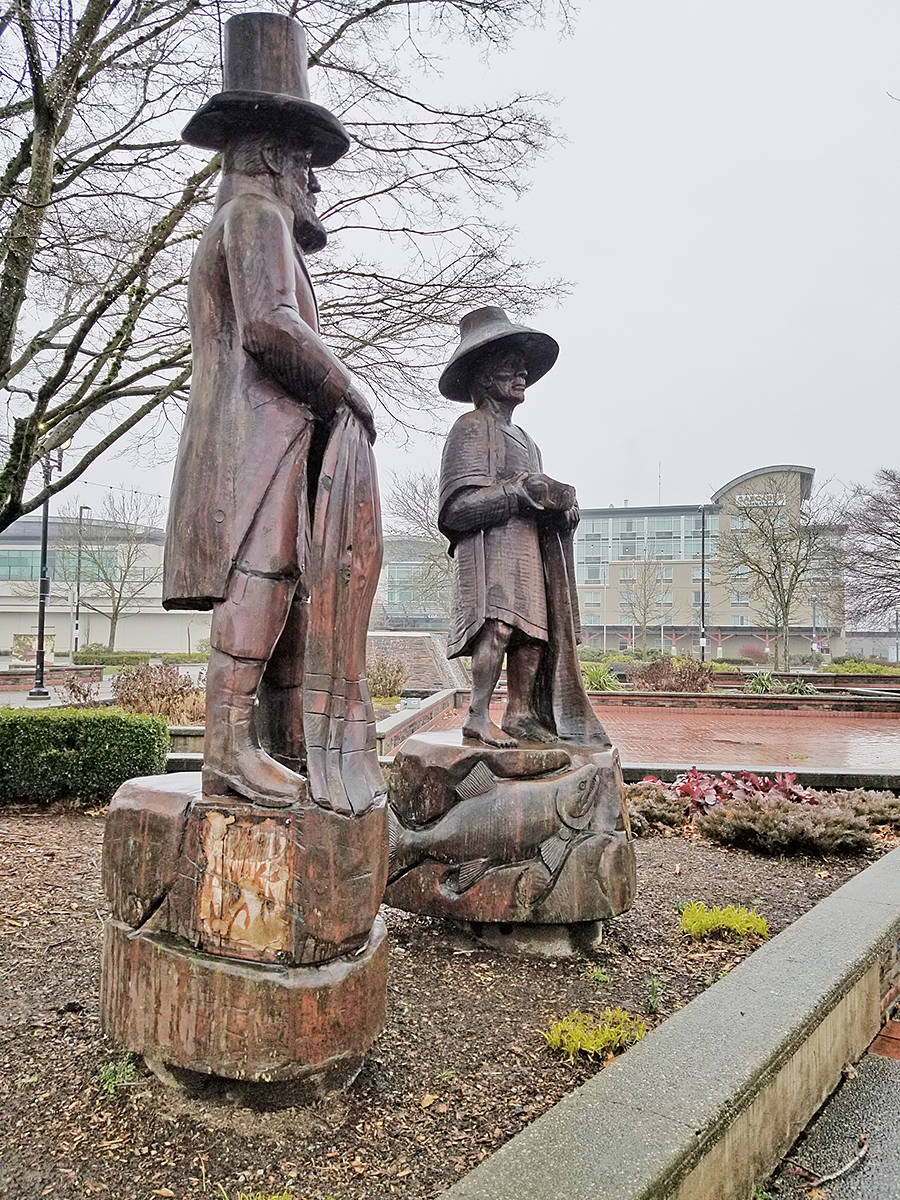 """Metal plaques have been pried from the base of Steve Ryan's Langley City statues, """"The Traders,"""" seen on Sunday, Feb. 28, at Innes Corners plaza (Dan Ferguson/Langley Advance Times)"""