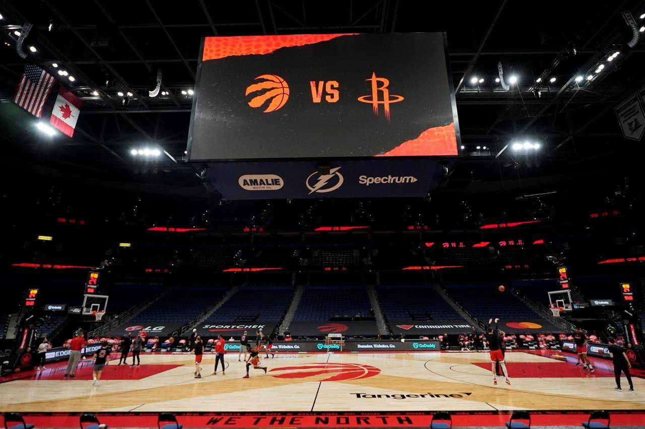 Some members of the Toronto Raptors and Houston Rockets take part in a shoot around before an NBA basketball game Friday, Feb. 26, 2021, in Tampa, Fla. THE CANADIAN PRESS/AP, Chris O'Meara