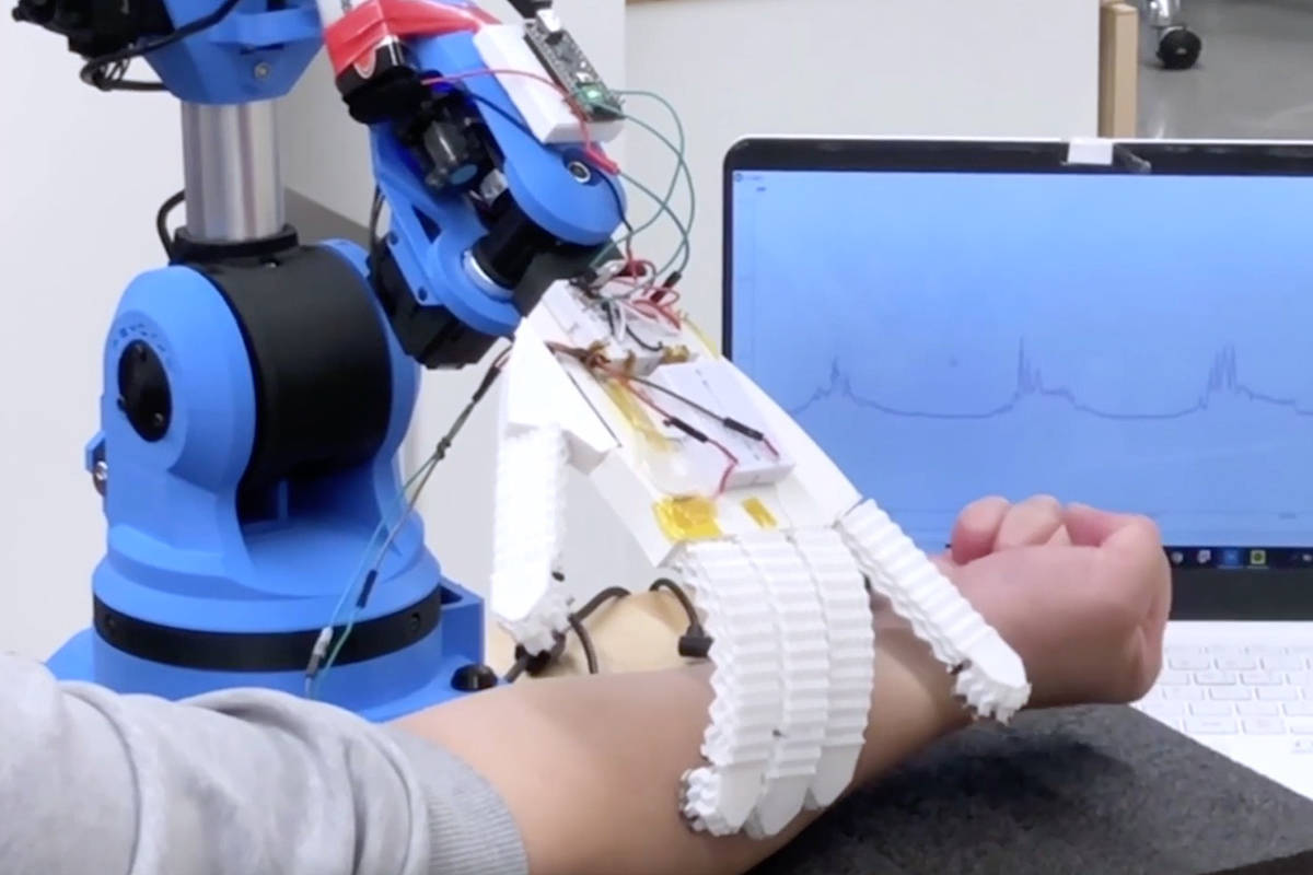 This robotic arm, built in SFU's Surrey campus, can measure heart rate, breathing, temperature and muscle movements. (Dr. Woo Soo Kim)