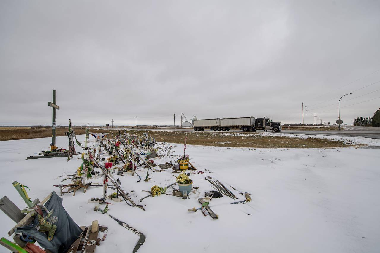 A memorial for those killed and injured in a deadly crash involving the Humboldt Broncos junior hockey team bus is visible at the intersection of Highways 35 and 335 near Tisdale, Sask., on Tuesday, Oct. 27, 2020. THE CANADIAN PRESS/Liam Richards