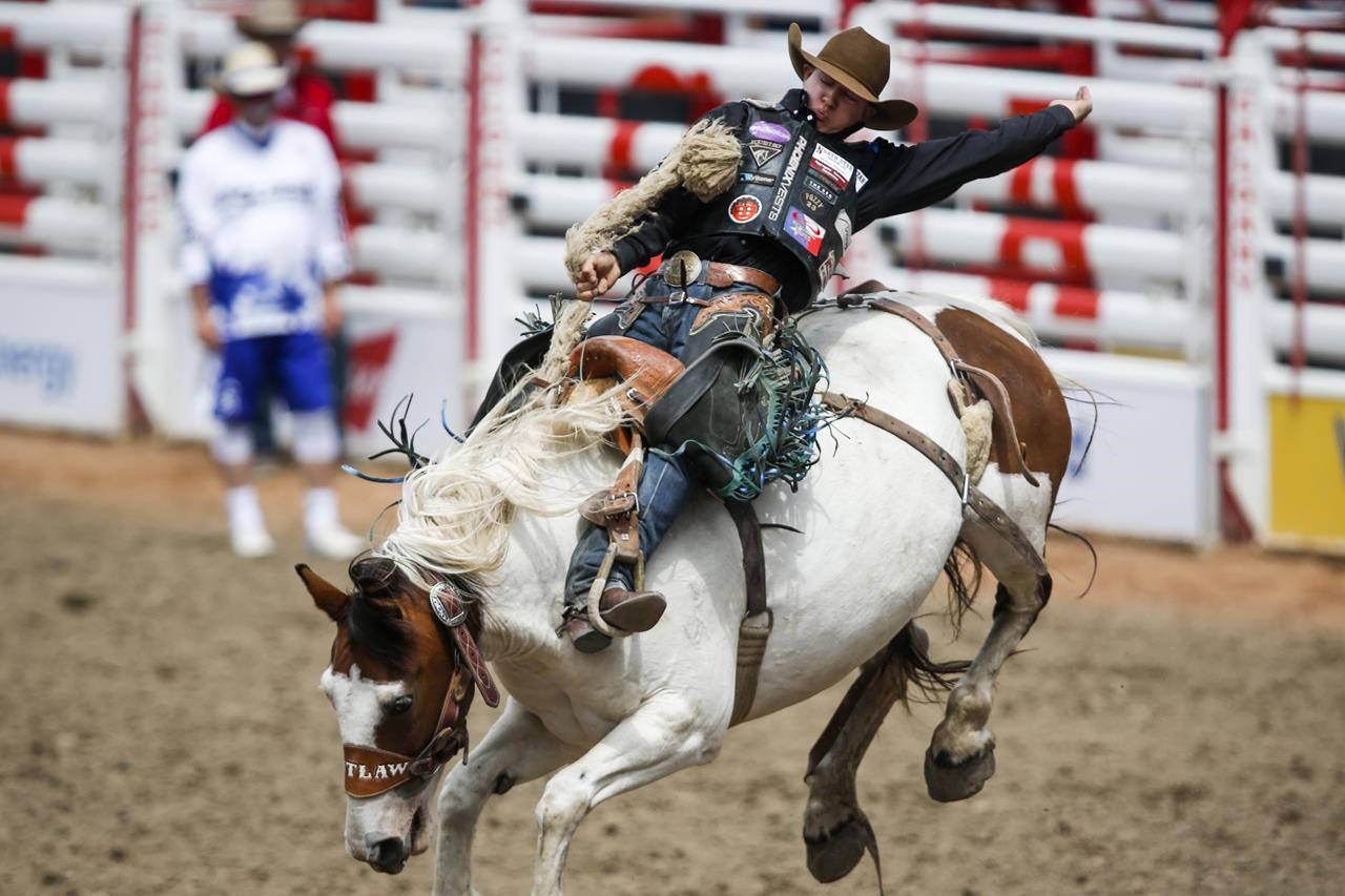 Zeke Thurston, of Big Valley, Alta., rides Lunatic Party during saddle bronc rodeo semi-final action at the Calgary Stampede in Calgary, Sunday, July 14, 2019. Thurston is among five Canadians competing in the 2020 world championship of rodeo Dec. 3-12 in Arlington, Texas. THE CANADIAN PRESS/Jeff McIntosh