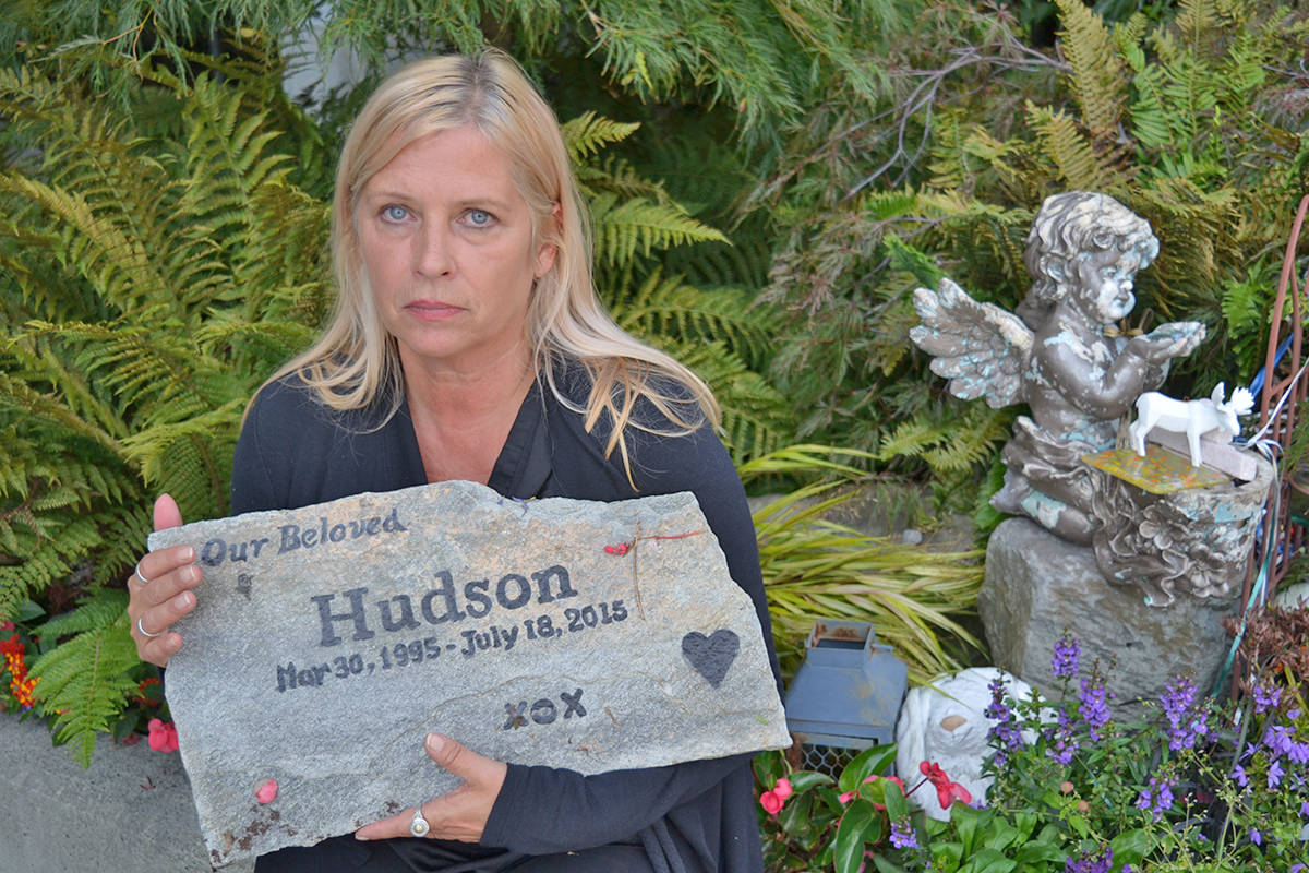 Jennifer Brooks with a stone tablet that adorns the memorial to her son Hudson, outside the South Surrey RCMP detachment parkade where he was fatally shot by police in July 2015. (File photo)