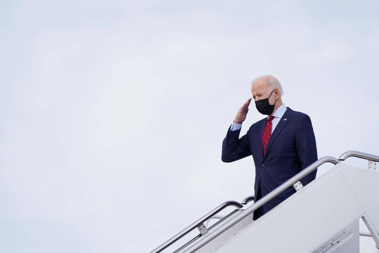 President Joe Biden salutes as he boards Air Force 1 at Andrews Air Force Base, Md., Saturday, Feb. 27, 2021. Biden is spending the weekend at his home in Delaware. THE CANADIAN PRESS/AP, Patrick Semansky