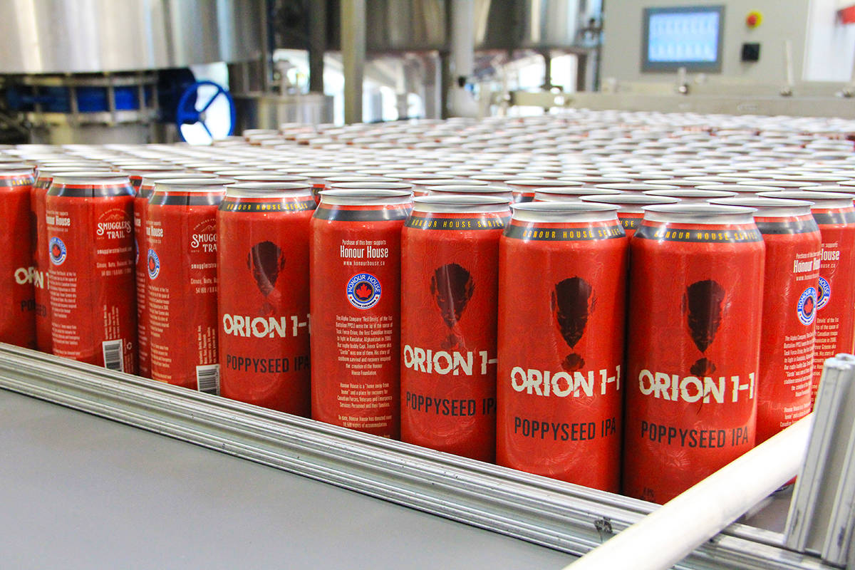 Empty cans of Orion 1-1 shuffle through a canning line at Smugglers' Trail Caskworks. (Photo: Malin Jordan)