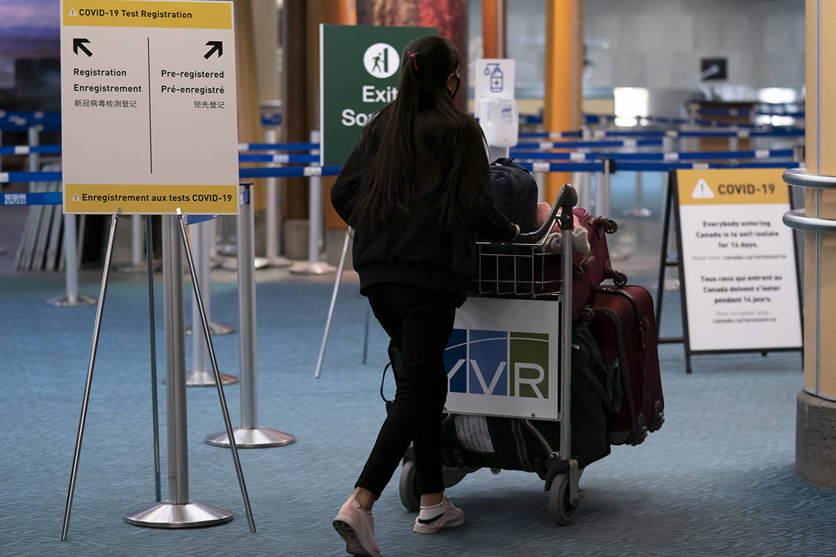 Signage for a new COVID-19 screening centre is pictured at Vancouver International Airport in Richmond, B.C. Friday, February 19, 2021. The centre is being set up to allow for the new testing requirements coming into effect Sunday. THE CANADIAN PRESS/Jonathan Hayward