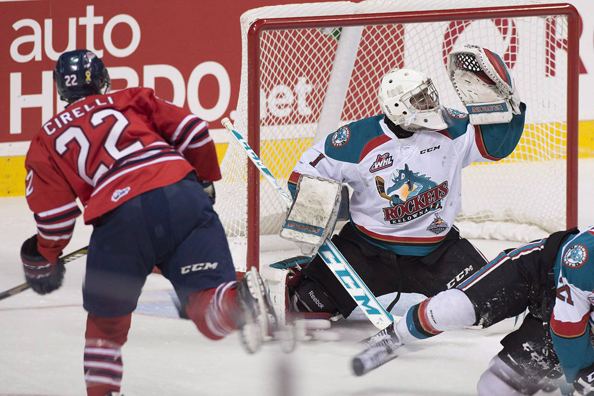 FILE – Oshawa Generals forward Anthony Cirelli, left, shoots and scores his team's first goal against Kelowna Rockets goalie Jackson Whistle during second period action at the Memorial Cup final in Quebec City on Sunday, May 31, 2015. THE CANADIAN PRESS/Jacques Boissinot