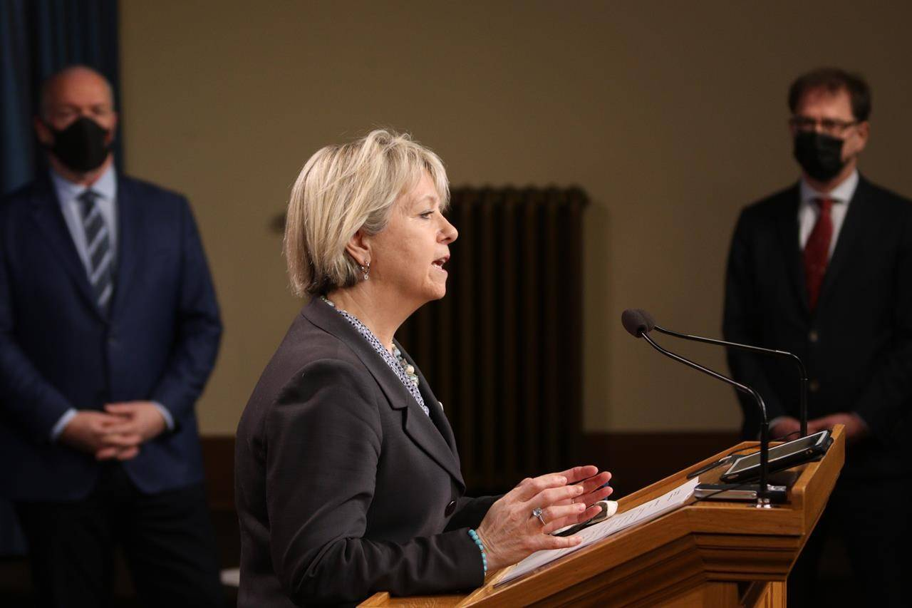 Dr. Bonnie Henry talks about phase two in B.C.'s COVID-19 immunization plan as Premier John Horgan and Minister Arian Dix look on during a press conference at Legislature in Victoria, B.C., on Monday, March 1, 2021. THE CANADIAN PRESS/Chad Hipolito