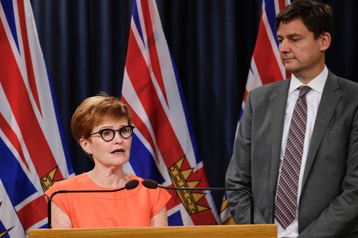 B.C. Attorney General David Eby introduces former NDP cabinet minister Joy MacPhail as chair of the ICBC board Aug. 19, 2018. (B.C. government)