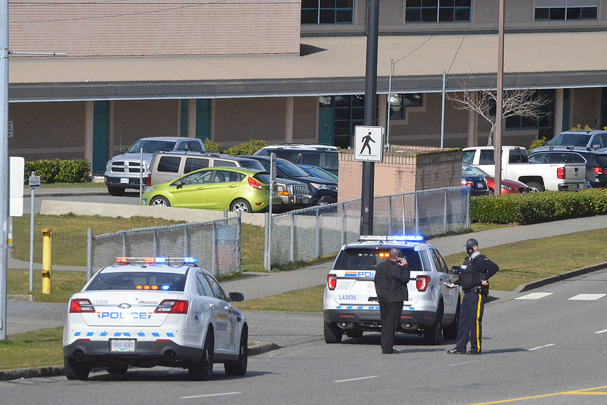 Langley RCMP outside of Walnut Grove Secondary on Wednesday, March 3, 2021. (Matthew Claxton/Langley Advance Times)