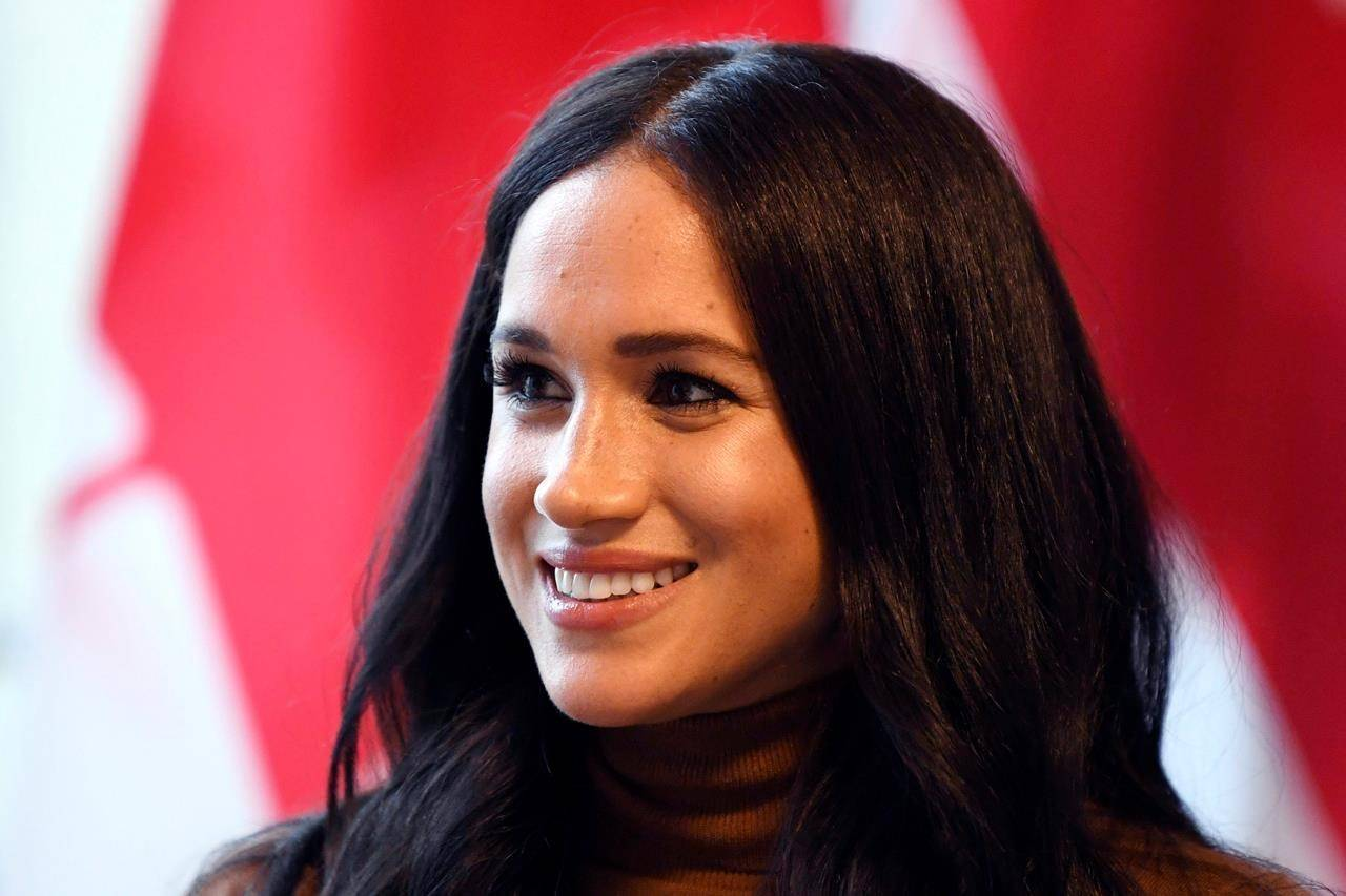 "FILE - In this Tuesday, Jan. 7, 2020 file photo, Meghan, Duchess of Sussex smiles during her visit with Prince Harry to Canada House, in London. Buckingham Palace said Wednesday, March 3, 2021 it was launching an investigation after a newspaper reported that a former aide had made a bullying allegation against the Duchess of Sussex. The Times of London reported allegations that the duchess drove out two personal assistants and left staff feeling ""humiliated."" (Daniel Leal-Olivas/Pool Photo via AP, file)"
