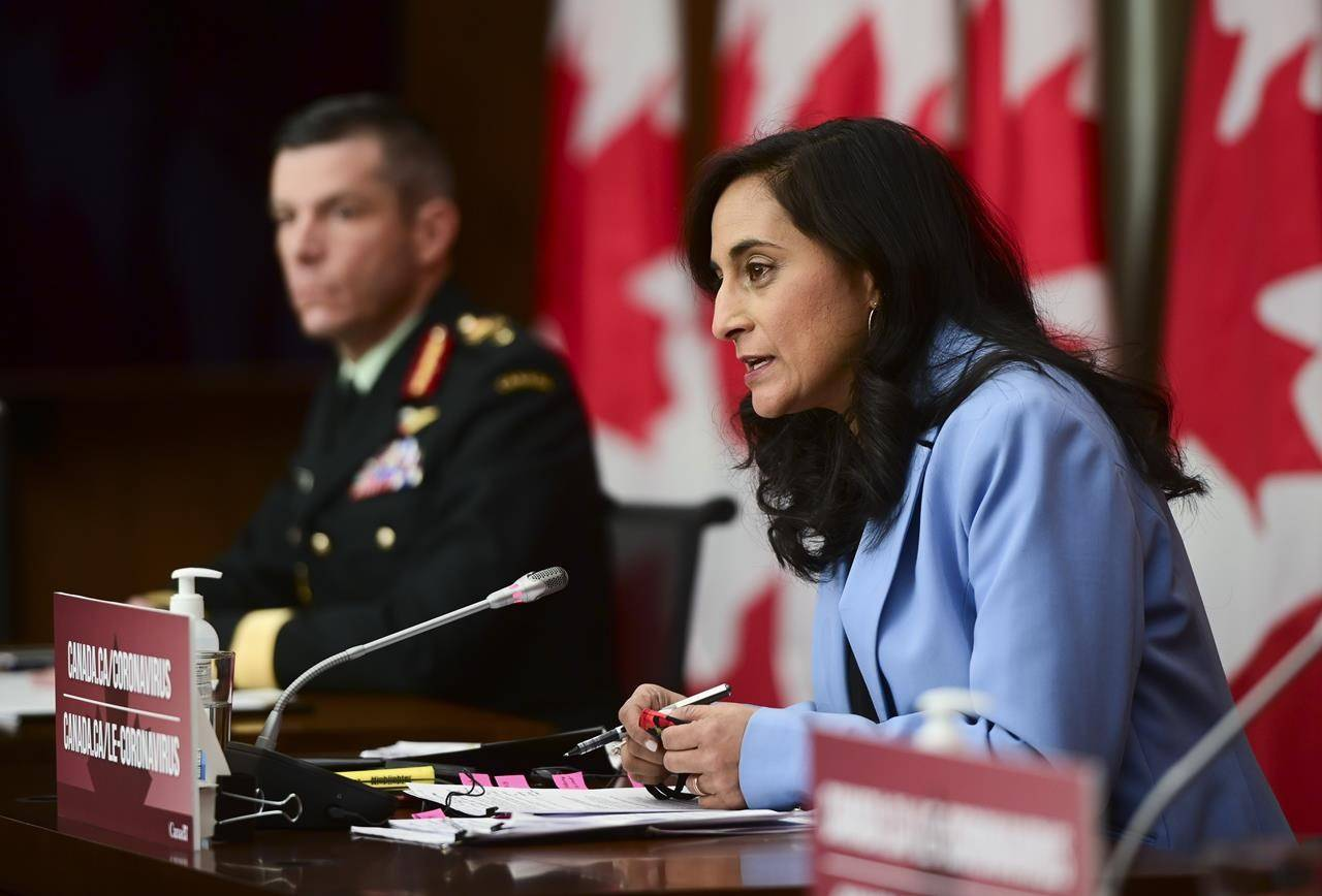 Major-General Dany Fortin, left, looks on as Minister of Public Services and Procurement Anita Anand provides an update on the COVID-19 pandemic, in Ottawa, Tuesday, Dec. 15, 2020. The Public Health Agency of Canada has set aside up to $5 billion to pay for COVID-19 vaccines. THE CANADIAN PRESS/Sean Kilpatrick
