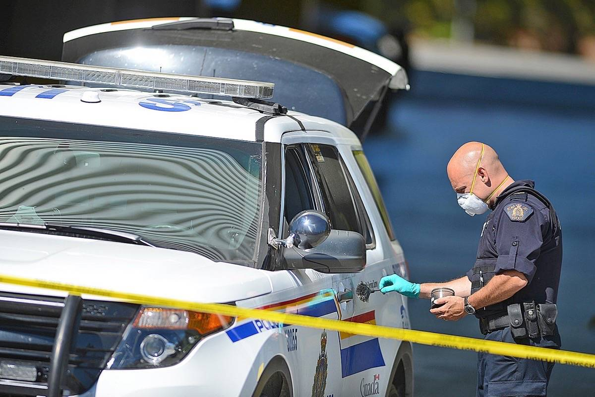 An officer collects forensic evidence from a police SUV following the July 18, 2015 incident that ended in the police-shooting death of Hudson Brooks in South Surrey. (File photo)