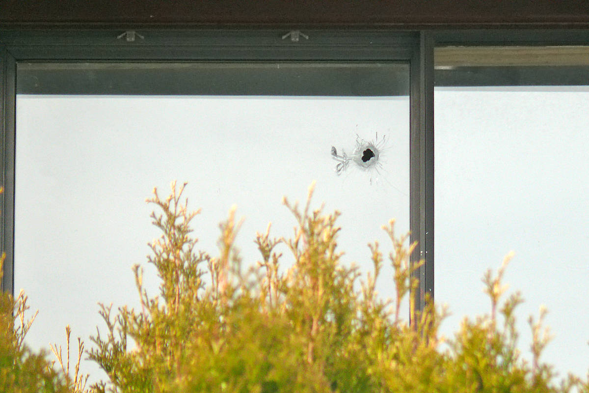 What appeared to be a bullet hole could be seen in a window of a house on 199th Street near 53rd Avenue early Wednesday, March 3, 2021 after several shots were fired. One person was arrested by RCMP. (Dan Ferguson/Langley Advance Times)