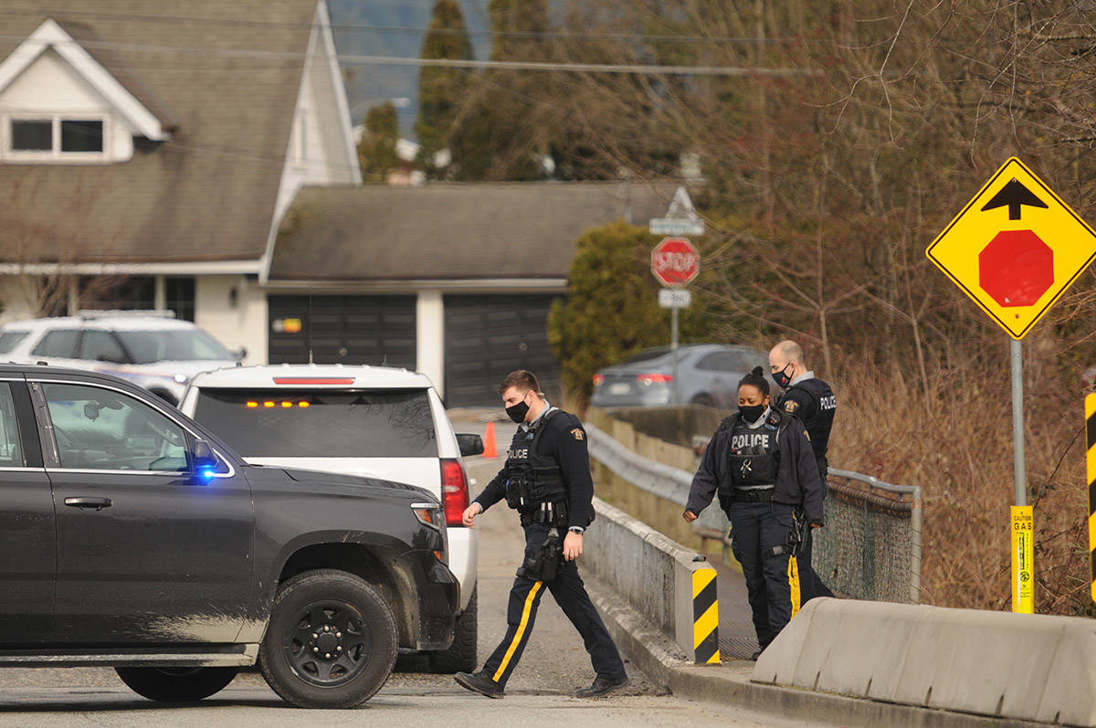 RCMP were on scene under the Menzies Street bridge in Chilliwack on Thursday, March 4, 2021 where a body was found. (Jenna Hauck/ Chilliwack Progress)