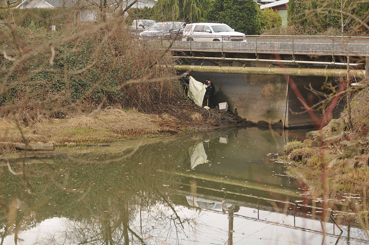 RCMP were on scene under the Menzies Street bridge in Chilliwack on Thursday, March 4, 2021 where a body was found. (Jenna Hauck/ Chilliwack Progress)