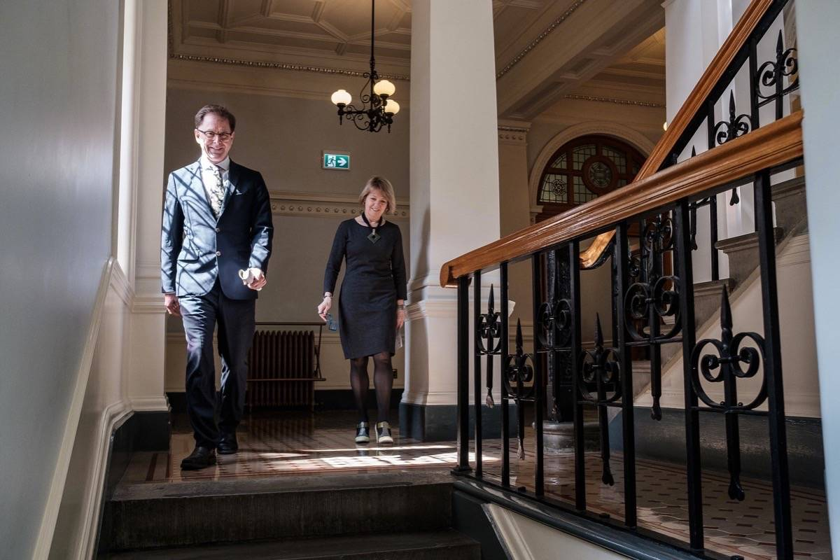 B.C. Health Minister Adrian Dix and provincial health officer Dr. Bonnie Henry head for the B.C. legislature press theatre to give a daily update on the COVID-19 pandemic, April 6, 2020. (B.C. government)
