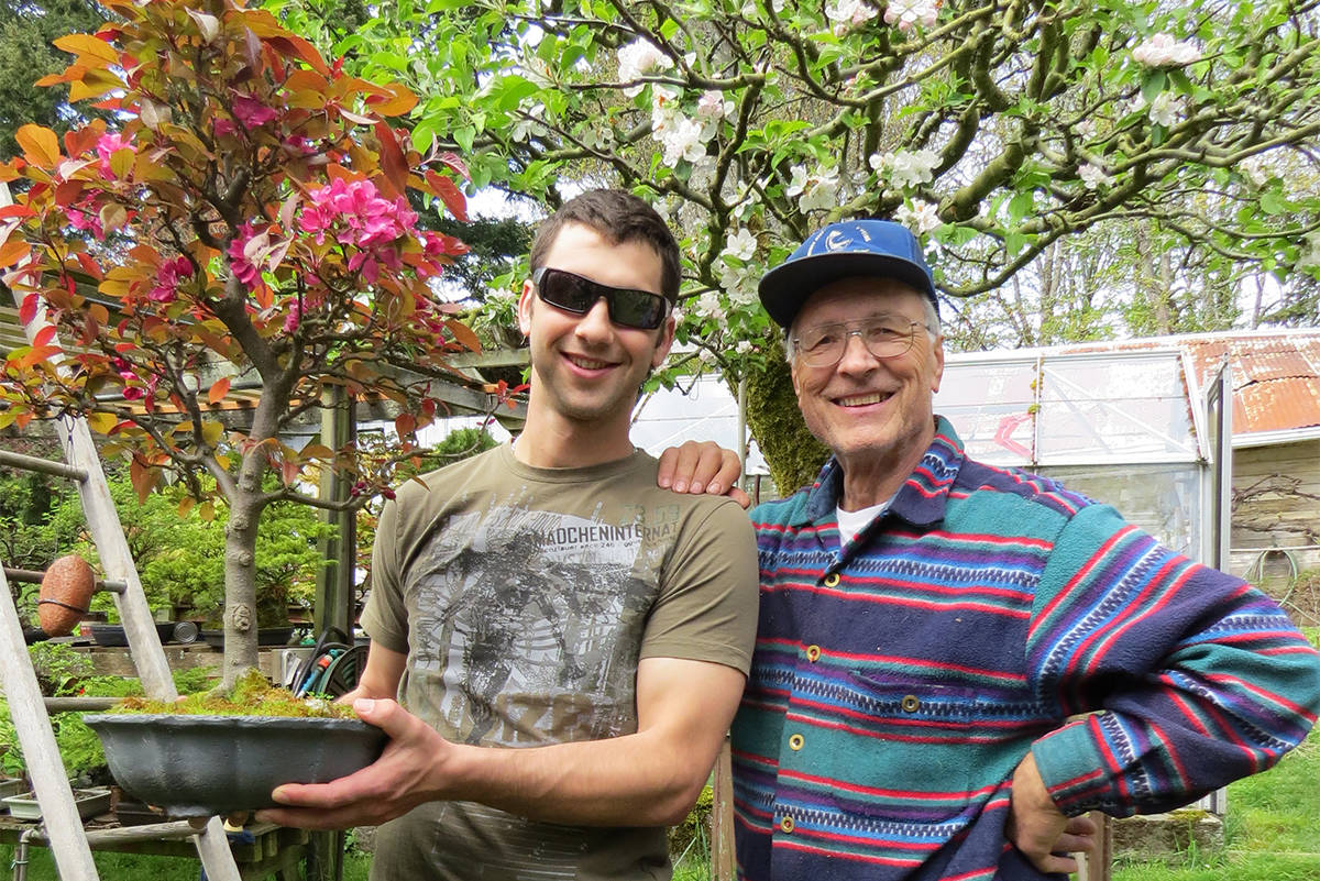 Darcy Rhodes (left) says his grandfather's bonsai trees are his 'babies.' (Courtesy of Tamara Bond)