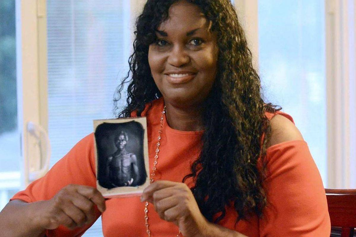 Tamara Lanier holds an 1850 photograph of Renty, a South Carolina slave who Lanier said is her family's patriarch, at her home in Norwich, Connecticut. (John Shishmanian/AP)