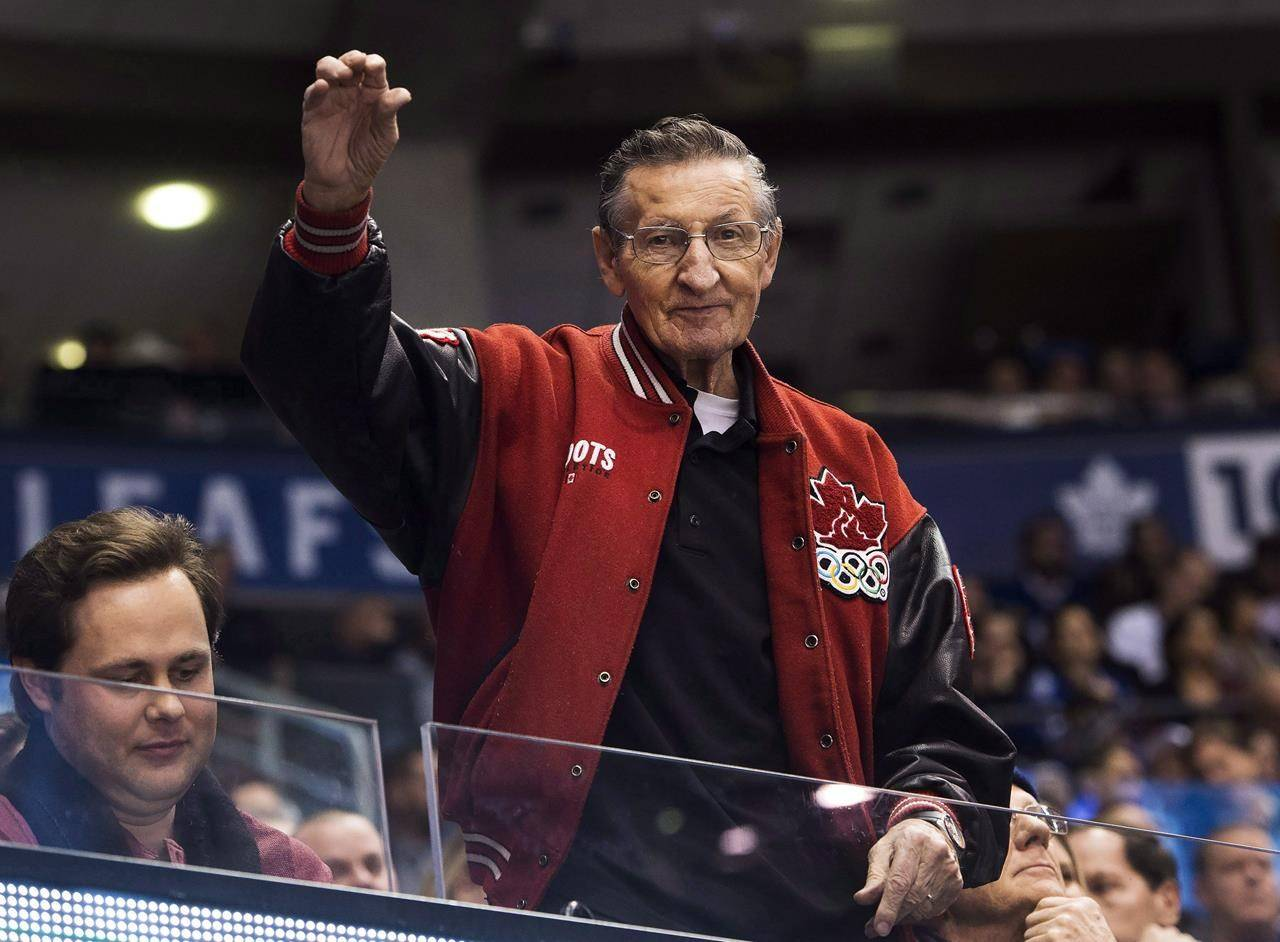 Walter Gretzky father of hockey hall-of-famer Wayne Gretzky waves to fans as the Buffalo Sabres play against the Toronto Maple Leafs in Toronto on Tuesday, January 17, 2017. THE CANADIAN PRESS/Nathan Denette