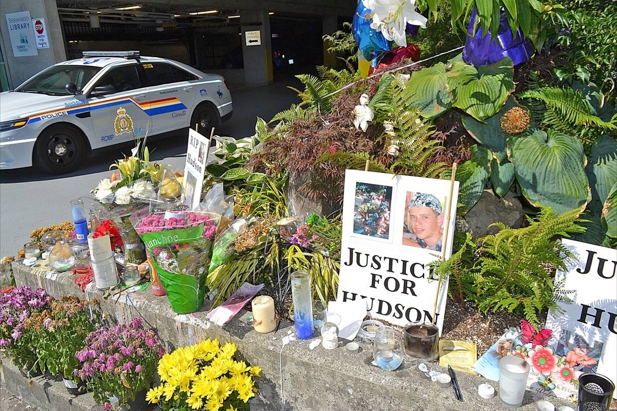 A memorial to Hudson Brooks grew quickly outside the South Surrey RCMP detachment following his July 2015 death at the hands of police. (File photo)