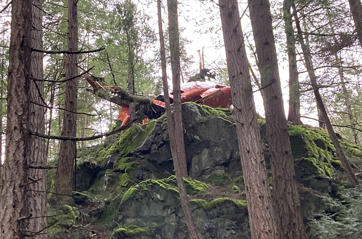 A crashed helicopter is seen near Mt. Gardner on Bowen Island on Friday March 5, 2021. Two people were taken to hospital in serious but stable condition after the crash. (Irene Paulus/contributed)