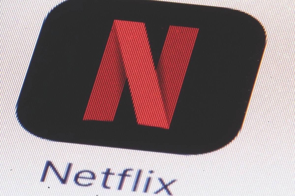 The Netflix logo on an iPhone. B.C. delayed imposing sales tax on digital services and sweetened carbonated beverages as part of its response to COVID-19. Those taxes take effect April 1, 2021. THE CANADIAN PRESS/AP, Matt Rourke