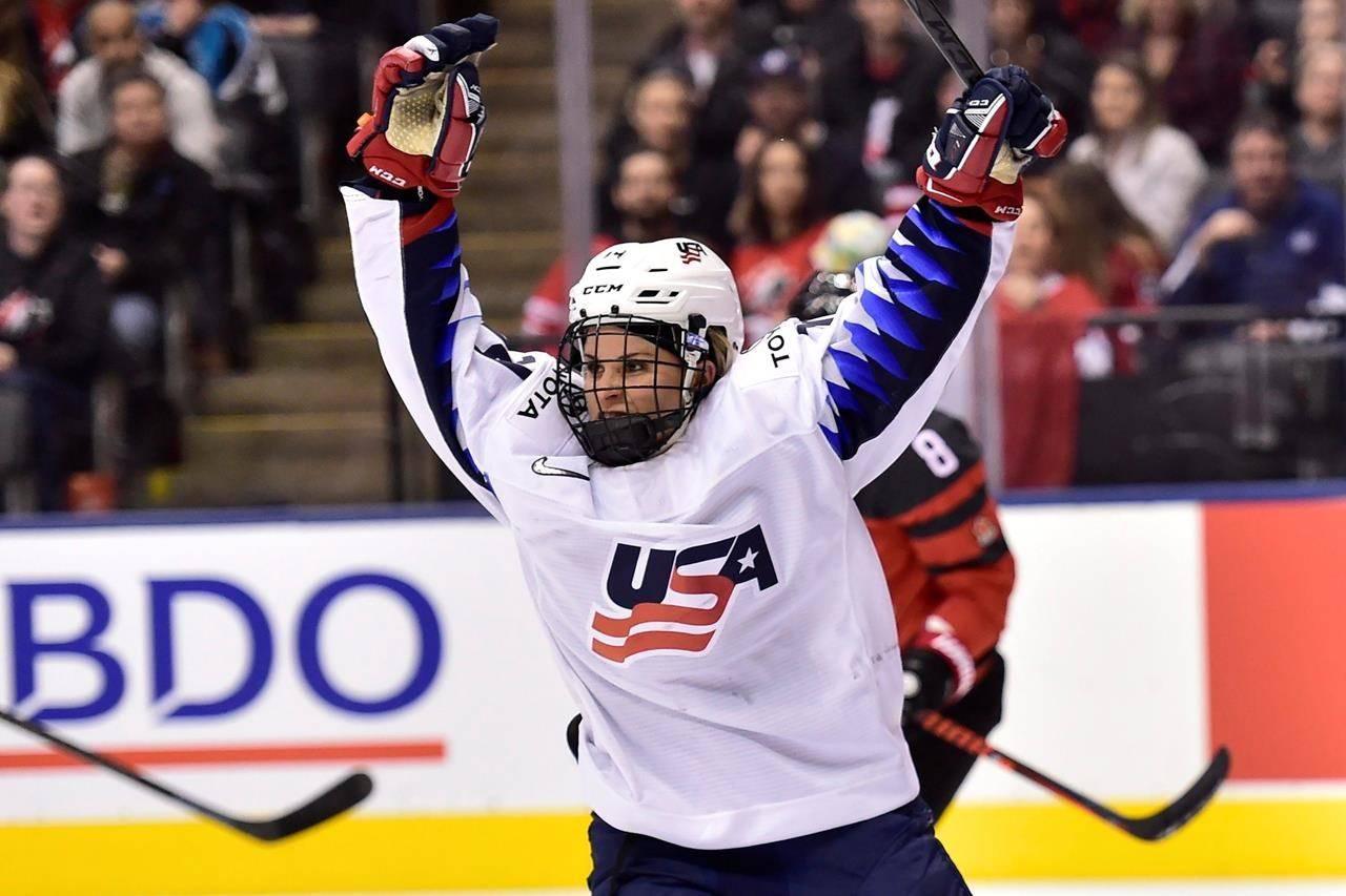 U.S. forward Brianna Decker (14) celebrates scoring against Canada during the third period of a Rivalry Series hockey game in Toronto. (Frank Gunn/The Canadian Press via AP, File)