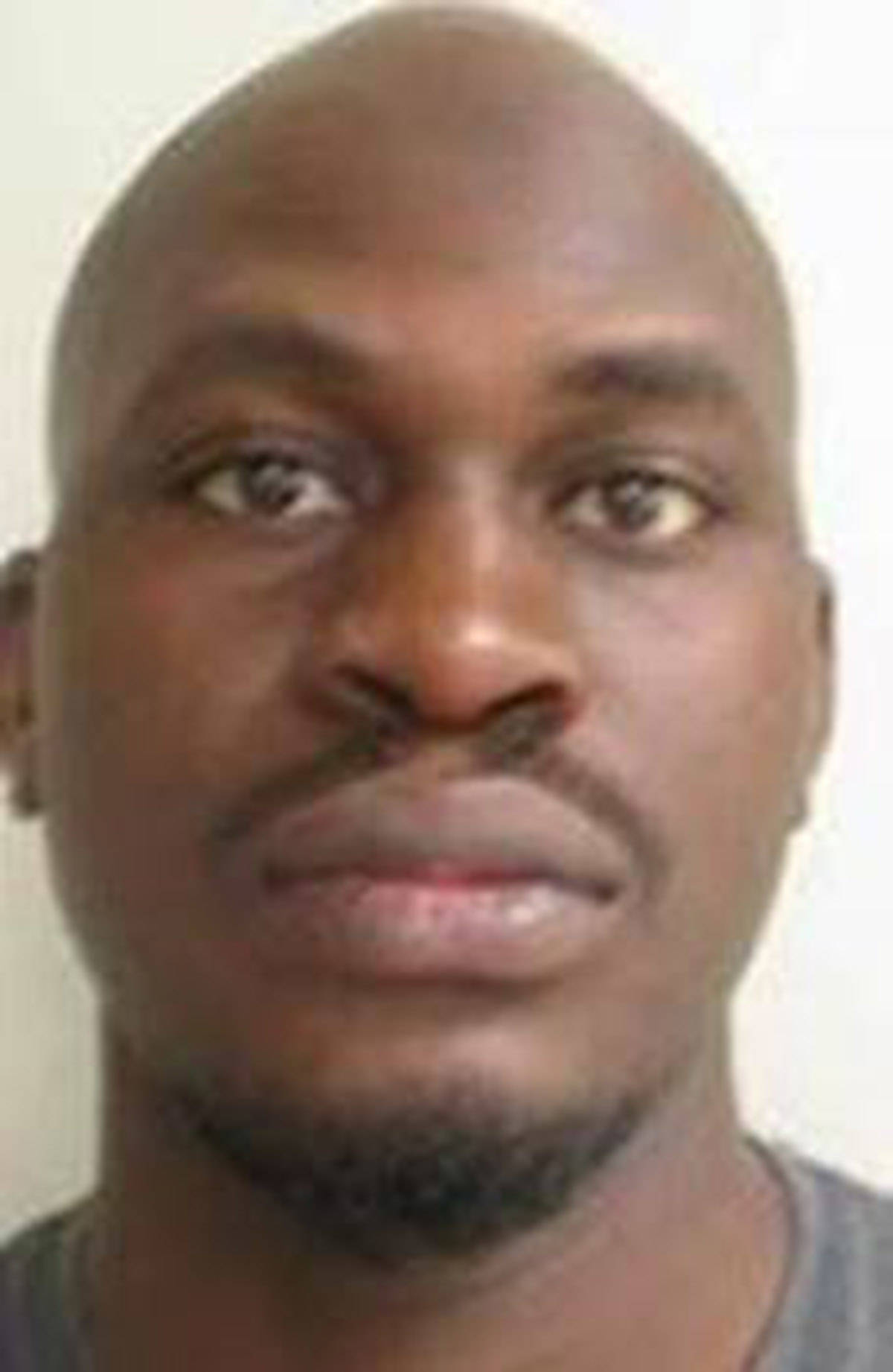 """Name: ABUBAKAR, Taiseer Age: 30 Height: 6'2"""" ft Weight: 175 lbs Hair: Bald Eyes: Brown Wanted: Armed Robbery Warrant in effect: February 04, 2021 Parole Jurisdiction: New Westminster, B.C."""