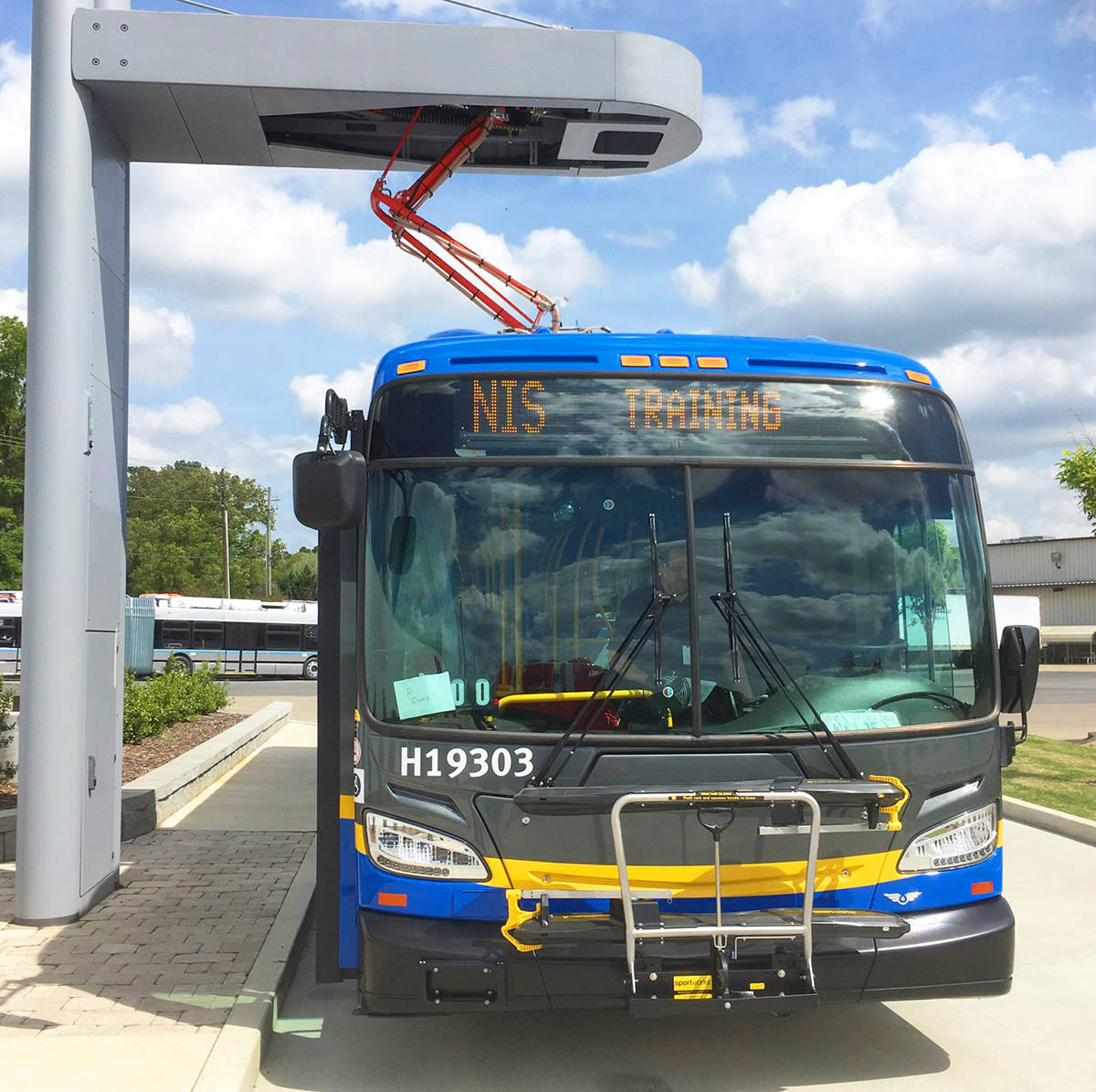 A battery-powered bus at a charging station. (TransLink)