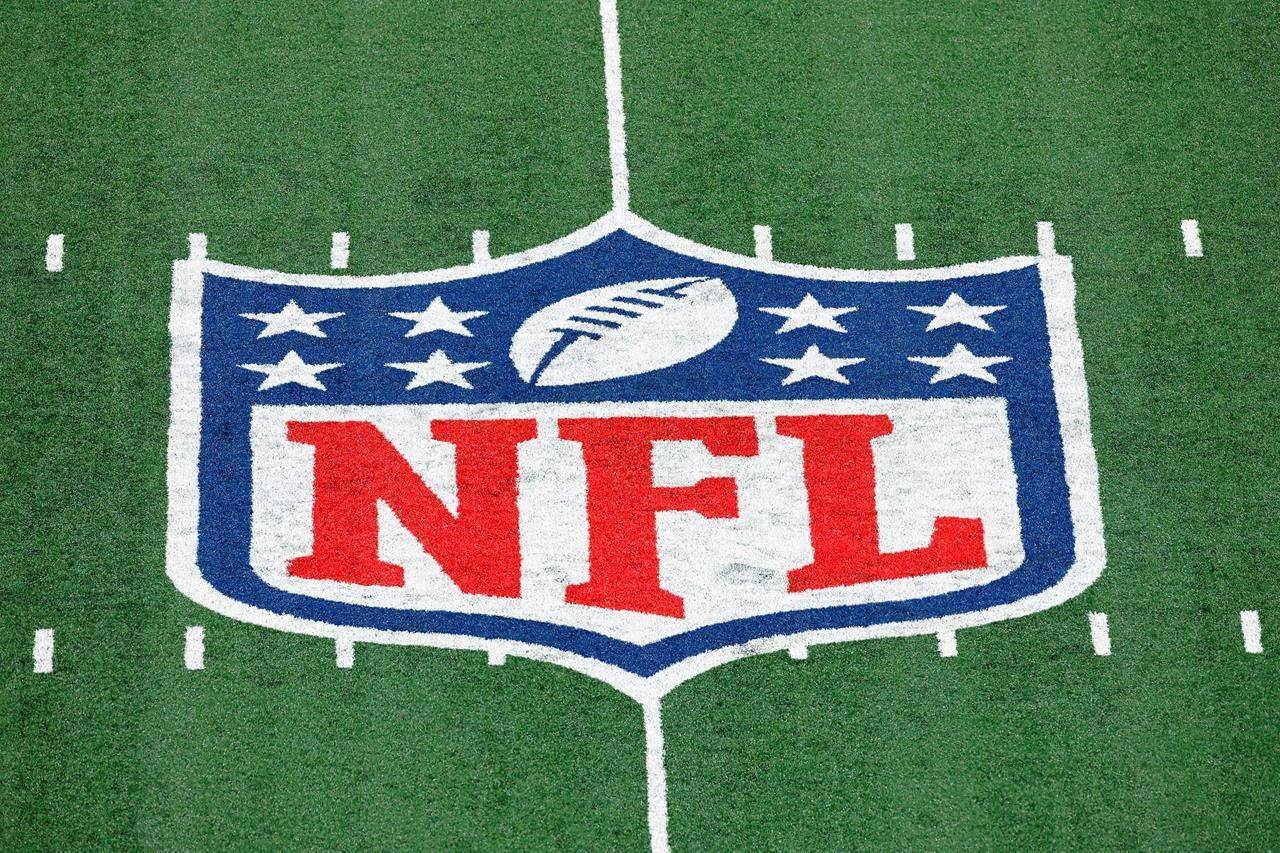 The NFL logo is displayed at midfield during an NFL football game between the Tampa Bay Buccaneers and the New York Giants in East Rutherford, N.J. (AP Photo/Adam Hunger, FIle)