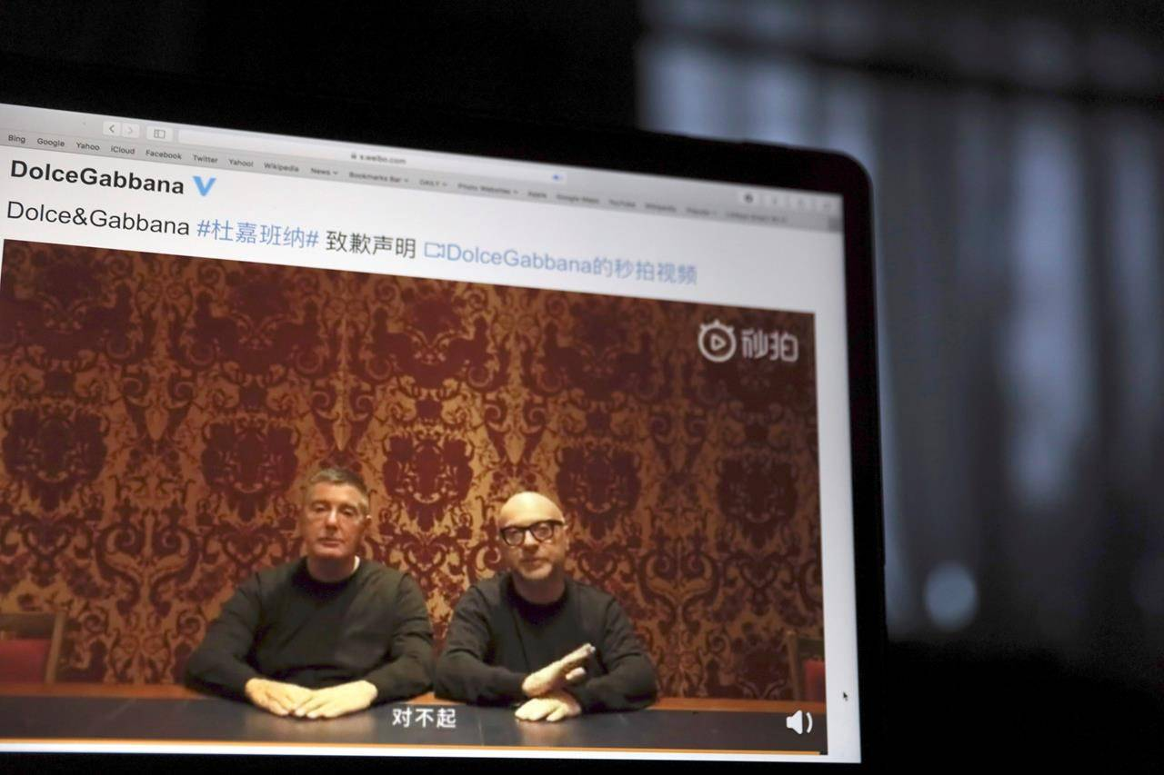 The Milan fashion house Dolce & Gabbana filed a multi-million-dollar defamation suit in an Italian court against U.S. fashion bloggers who reposted anti-Asian comments attributed to one of the designers that led to a boycott by Asian consumers (AP Photo/Ng Han Guan, File)